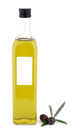 Square bottle with olive oil and leaves Stock Photo