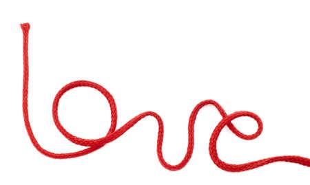 festividad: Palabra amor escrita con cuerda de color rojo