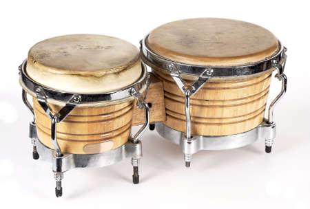 bongos: Bongos drums percussion instruments on a white Stock Photo