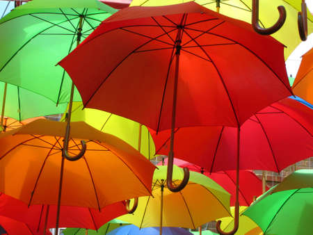 color: Colourful Display of Umbrellas at Eastbourne, East Sussex, England,UK Stock Photo