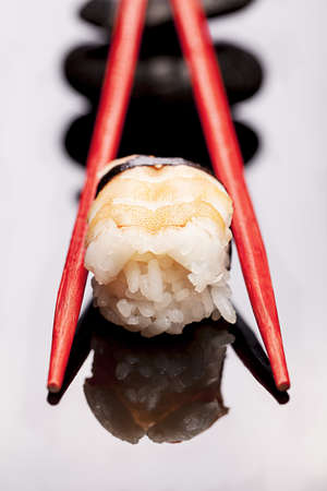 hashi: Shrimp Sushi with chopsticks red isolated over white background