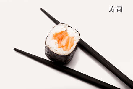 egg roll: Sushi of salmon and Chopsticks isolated on a white background  Stock Photo