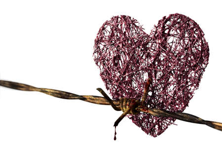 red heart in barbed wire punctured photo