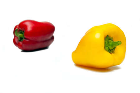 Two pepper are isolated on a white background