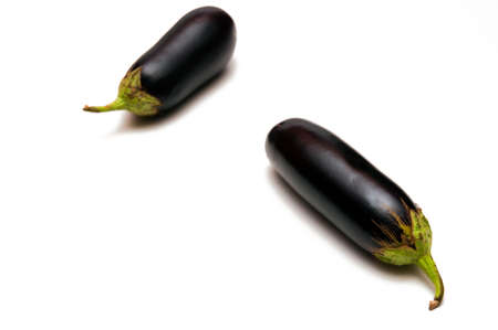 Two eggplants are isolated on a white background