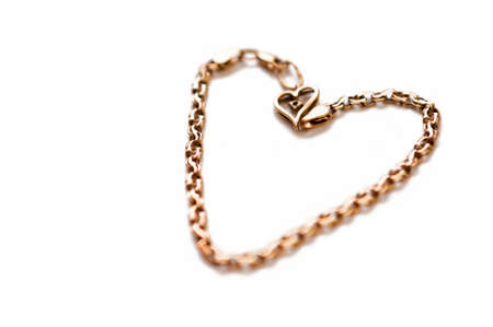 Gold coulomb in the form of heart Stock Photo