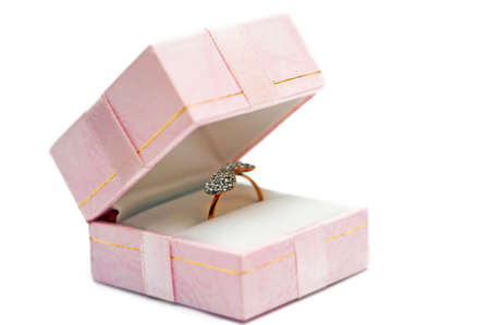 A wedding ring in the package on a white background Stock Photo