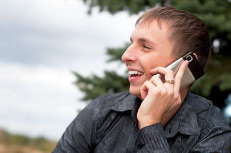 Portrait of casual young man talking on cellphone Stock Photo
