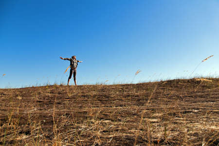 A beautiful young woman experiencing freedom or good time among dunes in the recent warm days of autumn