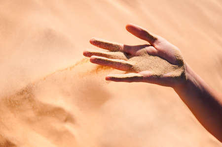 Sand is falling from girls arm