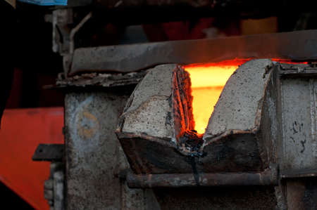 Molten metal is poured in a foundry