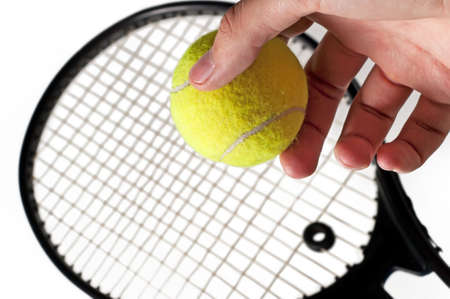 Tennis racket and the hand holding the ball. Isolated on a white background Stock Photo