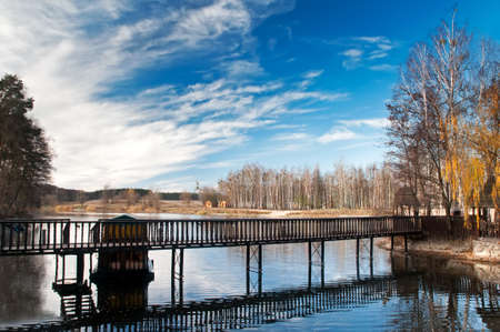 Wooden footbridge crosses the lake