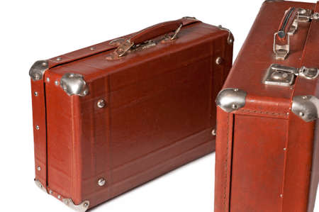 Two Very old brown suitcases are isolated on white
