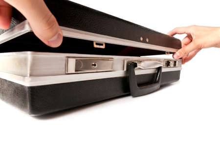 Man's hand open the old case Stock Photo - 8306478