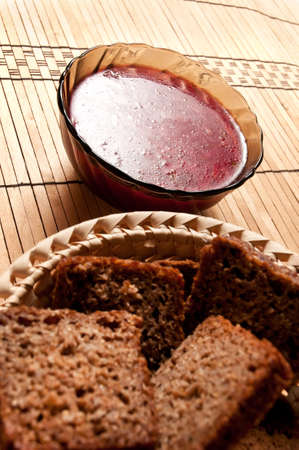 Bowl of fresh soup with black bread