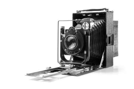Vintage folding camera isolated on white. Black and white Stock Photo