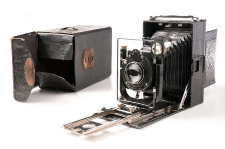 Old camera and cover isolated on white