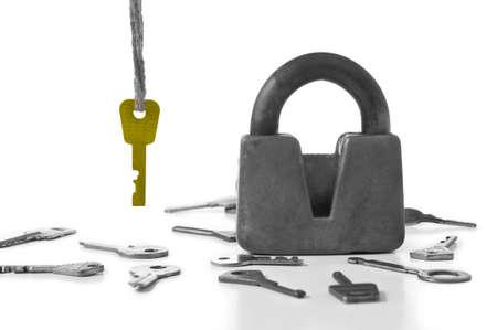 Many keys and lock one. Isolated on white