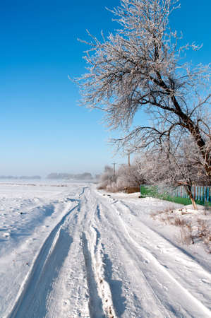 Russian village snow-covered road on a clear winter day Stock Photo