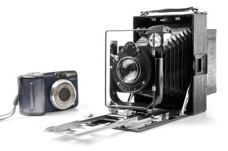 Old and modern camera isolated on white