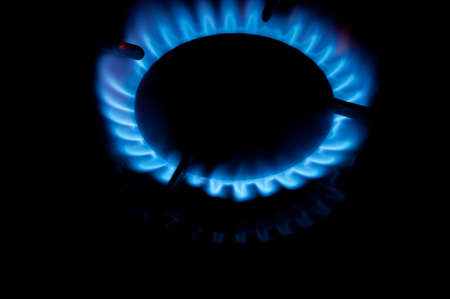 Gas burner with a flame burning. Home plate Stock Photo