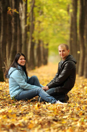 Young man and woman relaxing in the park and holding hands. Love