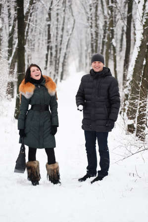 Young couple will have a snowball fight in the park Stock Photo - 12064263