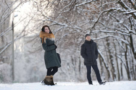 Young couple posing in winter park photo