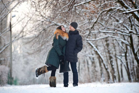 Young couple posing in winter park Stock Photo - 12064104