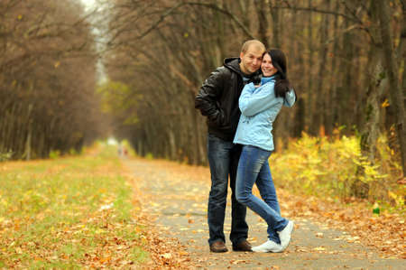 Young couple embracing and smiling in park