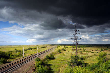 High voltage power line near the railway  Thunderstorm approaching