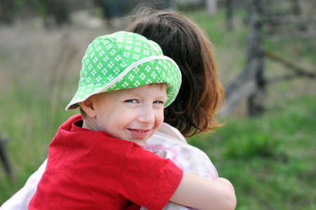 Smiling young boy sitting on shoulders  Half turned