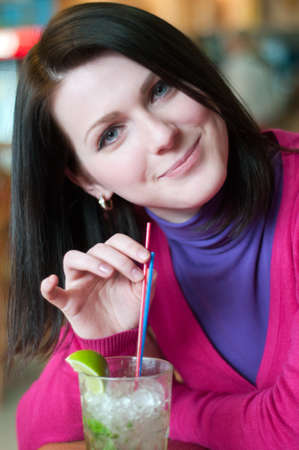 Young women drinking mojito in cafe Stock Photo - 12500952