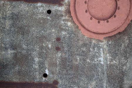 rusty sheet with manhole