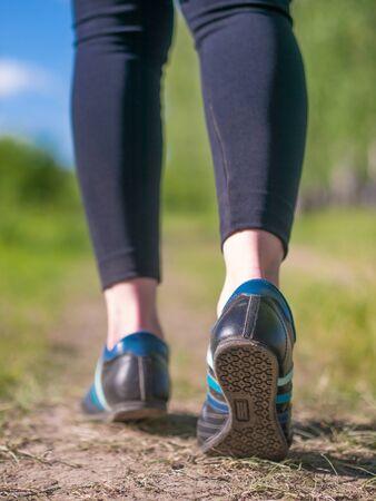 female legs in jogging shoes closeup