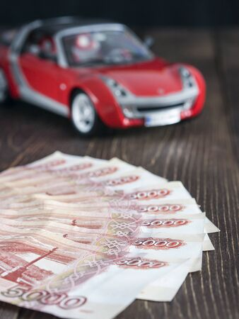 thousandth: Russian ruble five thousandth notes on a background with toy car Stock Photo