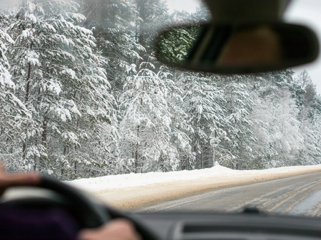 Winter driving. View from inside vehicle, unrecognizable driver