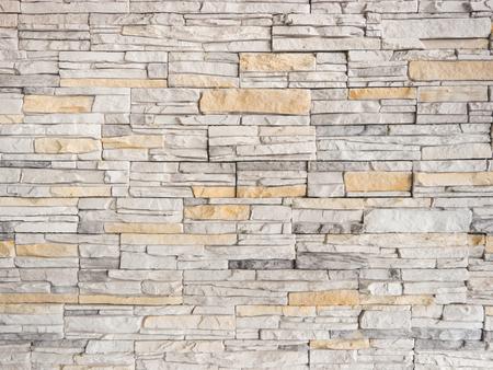 Una Pared De Una Fachada De Piedra Artificial De Color Gris Con ...