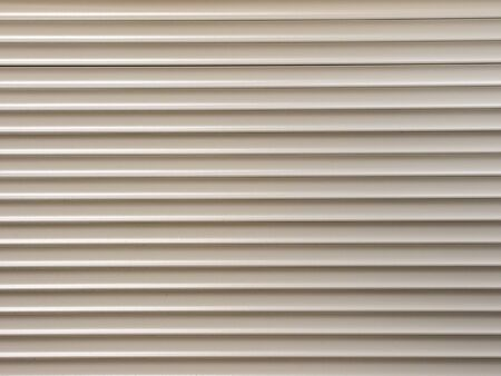 iron curtains: white metal roller shutter from shop door