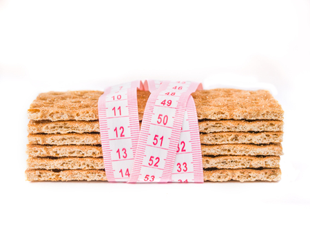 crispbread: Diet Crispbread and measuring tape isolated on white. Diet concept Stock Photo