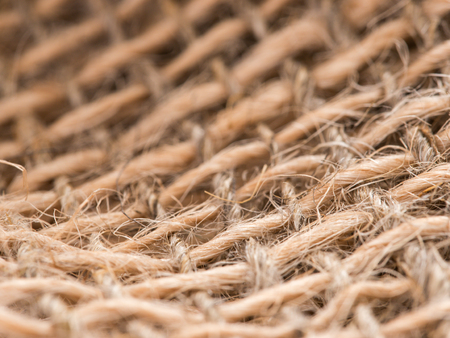 Skein of jute twine on sacking. Clew of natural rope. Close up