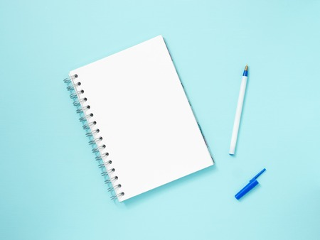 blank note: Top view of blank note paper with pen on blue wood table for background