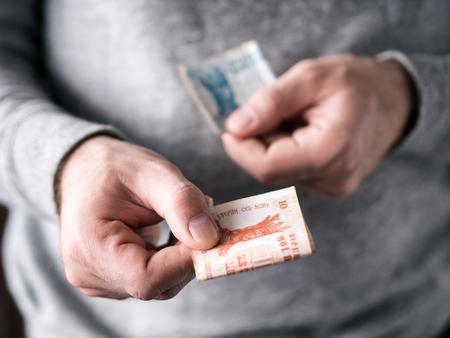 Hands hold Moldovan leu. Selective focus. Shallow DOF