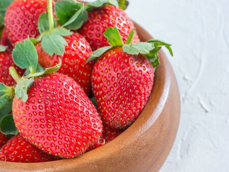 strawberries in wooden bowl Stock Photo