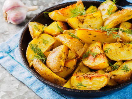 galvanized: Close up view of backed potatoes in cast iron skillet