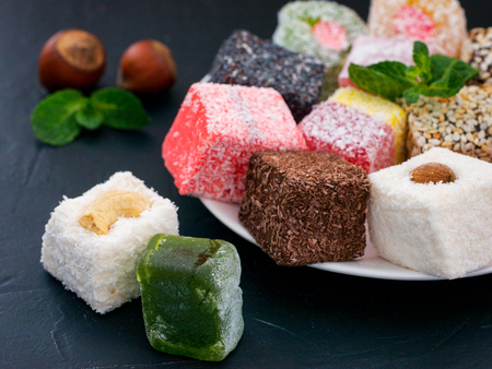 Turkish delight on black rustic background