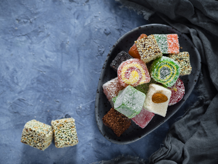 Turkish delight on blue concrete background, copy space Stock Photo