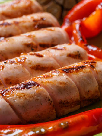 Grilled chicken sausages close up