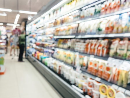 blur of supermarket refrigerator and customer Reklamní fotografie - 83490840